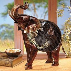 The trunk is up on this African Safari Elephant Figurine Fan from Deco Breeze.