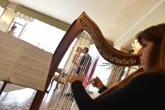 Sarah with her celtic harp, one of the romantic instruments