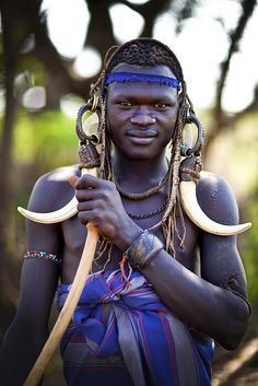 Mursi warrior - Ethiopia by Steven Goethals, via Flickr  The Mursi live in Mago National Park near Jinka. They grow crops and herd cattle. The women are famous for wearing lipplates. The Mursi also have a lot of scarifications on their bodies.
