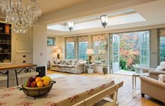 I love the atmosphere in this room bringing the garden inside Explore Westbury Garden Rooms' case studies: glass garden rooms through to wooden orangeries, conservatories, pool houses and kitchen extension projects. Kitchen Diner Extension, Open Plan Kitchen, Orangery Extension Kitchen, Kitchen Extension French Doors, Conservatory Extension, Kitchen Floor, Kitchen Layout, Kitchen Family Rooms, Living Room Kitchen