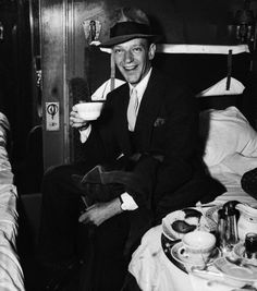 Fred Astaire drinking coffee.