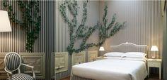 Milan Hotel fairy tale decor stripe vines room...