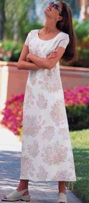 Modest floral pullover dress with matching shoes.  Is she talking to a basketball player?  Chadwicks c. 1996