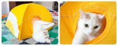 A todos los gatos les gusta esconderse en lugares pequeños. Con este proyecto, podrás satisfacer los deseos de tu compañero felino. Hazle una carpa a tu mascota usando sólo dos perchas, un trozo de cartón y una camiseta vieja. El procedimiento es muy sencillo, te tomará unos pocos minutos tenerla lista. Además, te resultará muy fácil desarmarla para lavarla cuando sea necesario.   Materiales  - Una camiseta mediana - Un trozo de cartón de 38 x 38 cm. - Dos perchas de alambre - Cinta adhesiva…