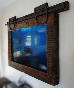 Custom Made Hanging TV.....a great twist on a barn door trend.