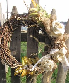 #Burlap roses with some dried, feathering leaves and world ribbon #wreath. Loving the #burlap  www.facebook.com/wreathswithareason
