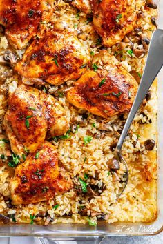 Easy Oven Baked Chicken And Rice With Garlic Butter Mushrooms mixed through is winner of a chicken dinner! Chicken thighs bake on top of buttery, garlicky, soft and tender rice with crispy edges. ALL the chicken flavours … Easy Oven Baked Chicken, Easy Chicken And Rice, Baked Chicken Recipes, Chicken Thighs In Oven, Chicken Rice Bake, Chicken Thigh Casserole, Baked Chicken And Mushrooms, Chicken Rice Mushroom Casserole, Oven Baked Rice