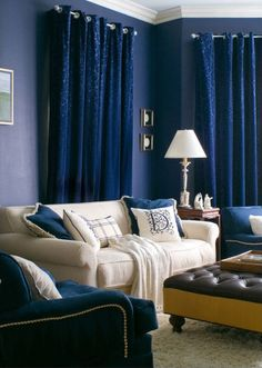 Drapes and wall color blend together, making a small room seem larger. Cobalt color everywhere makes this room dramatic. Design by Tracy Murdock Allied ASID.
