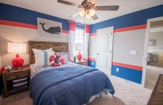The bright, nautical decor featured in this fun kids bedroom is perfect for any adventurer or beach lover! | Pulte Homes