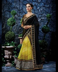 Black and yellow lehenga sari with heavy embroidered border   1. Yellow and black poly georgette lehenga sari2. Thread embroidered broad border3. Comes with matching unstitched blouse4. Can be stitched upto size 42 inches
