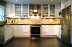 Large subway tile, white kitchen, stainless steel appliances