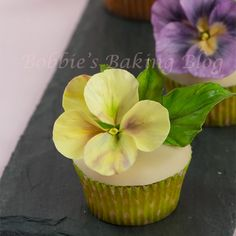 Delicate and exquisitely detailed, these darling gumpaste pansies are sure to add that finishing touch of floral delight to any batch of. Sugar Paste Flowers, Icing Flowers, Fondant Flowers, Cake Flowers, Fondant Figures, Fondant Cakes, Cupcake Cakes, Fondant Bow, Car Cakes