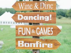 Wood wedding sign pointing to activities for guests