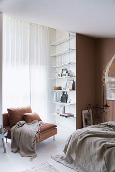 My Scandinavian Home's gorgeous bedroom makeover with Bemz | Lady Jotun Blushing Pink wallpaint | minimalist handing bookshelves | chestnut velvet armchair | Bemz bedspread in Unbleached Rosendal Linen | IKEA Söderhamn armchair with a Bemz slipcover in Chestnut Malmen velvet