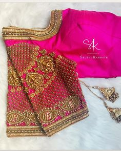 Stunning pink color bridal blouse with Lakshmi devi motifs on sleeves. Blouse with hand embroidery zardosi and bead work. 02 October 2018