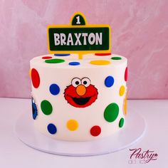 Sesame Street themed birthday cake with fondant details and a custom cake topper. Call or email us to design your dream cake today! #sesamestreetcakes #1stbirthdaycakes #sesamestreetpartyideas #sesamestreetbirthday #elmocake #cookiemonstercake #1stbirthdaypartyideas #1stbirthday #boybirthdayparty Sesame Street Birthday Cakes, Sesame Street Cake, Themed Birthday Cakes, Custom Cake Toppers, Custom Cakes, Elmo Cake, Cakes Today, Dream Cake, Specialty Cakes