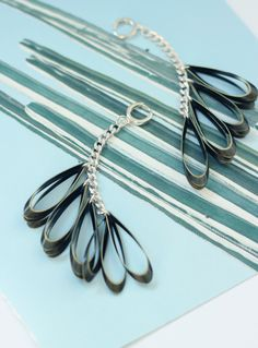 Handmade earrings. Materials Sterling silver hoops Silver plated chain Brass Measures Total lenght 11cm.