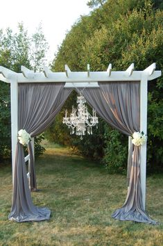 Maybe hanging burlap, then some of our flowers and wine bottles or mason jars on the pergola.
