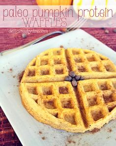 Healthy pumpkin protein waffles! An easy breakfast recipe to make over the holidays! Uses almond flour, egg whites, protein, pumpkin, and spices! Paleo recipe!