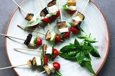 """When I first made these I used feta. It did work but feta, being a crumbly cheese, did not skewer that well. Fresh mozzarella is more """"rubbery"""" and easier to deal with. Vegetarian Recipes, Cooking Recipes, Fresh Mozzarella, Skewers, Caprese Salad, Cherry Tomatoes, Finger Foods, Eggplant, Stuffed Peppers"""