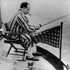Al Capone like you've never seen him before. Fishing on his yacht, 1931.
