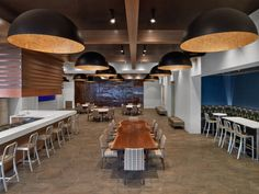 National Restaurant Associations Washington DC Headquarters / OTJ Architects. The heart of the space – just as in any good restaurant – is the studio kitchen located in the center of NRA's top floor. The studio kitchen is designed to fill multiple roles – exhibition kitchen, event space, meeting space, and the daily cafe for NRA staff.