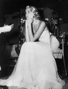 Grace Kelly on the set of To Catch a Thief, dressed by Edith Head for the fireworks scene.
