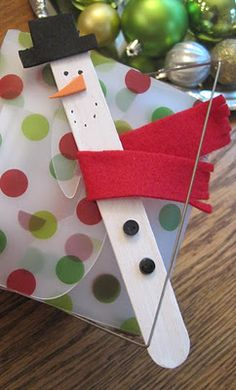 Maybe a make & take station for kids at the party? Snowmen popsicle stick ornaments?