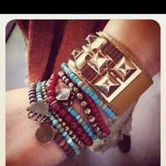 Love bracelets and then thick watches/bands!