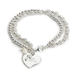 A strand of silver-polished beads joins with freshwater pearl and filigreed silvered beads for a striking inspirational gift, accented with a crystal-studded cross. Give our trinity bracelet to someone special who is celebrating a religious occasion or simply to brighten her day. Engrave it to remind her of what's important in life.<br /> <br /> -The round pearl feels perfect when paired with the two chain bracelet, one simple silver beads, the other with embellished pierced beads.<br ...