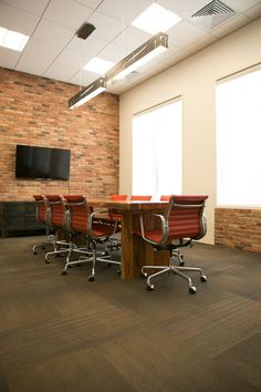 Nice meeting space with TV. King Cole Ducks Ontario Office Design