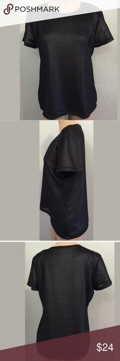 "Calvin Klein black large short sleeve top NWT Calvin Klein size large black short sleeve top. 100% Polyester. Bust 20"" armpit to armpit. Length 24 1/2"" shoulder to hem.!Measurements are approximate. MSRP $59.50 Calvin Klein Tops"