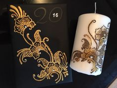 Henna Diary - Decorated with silver gems and an intricate design. Henna Candle - Decorated with gems, gold glitter and a beautiful floral design.