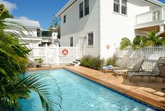 Key West Rentals - 5 BR 4.5 BA Exquisitely Key West yet exotically Cuban, this classy compendium of an elegant casa grande plus vintage casita is ideally located in the fascinating Upper South End of Duval Street.