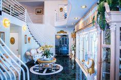 Art Deco Entryway with slate tile floors, Wall sconce, High ceiling