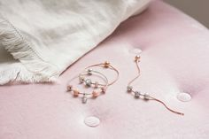 Go gorgeously two-tone with the PANDORA ESSENCE collection. Crafted in sterling silver and PANDORA Rose, our unique metal blend with a blush pink hue, these new bracelets and charms reflect your wonderful values. Pandora Essence Collection, Pandora Jewelry, Signature Style, Blush Pink, Delicate, Pearl Earrings, Charmed, Sterling Silver, Unique