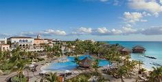 Sanctuary Cap Cana All-Inclusive Resort| Expedia Price- $2392 includes Junior King Oceanview Suite, All Meals, Airfare from DTW, Activities. +5 Star Resort +887% recommend +4.3/ 5 rating +Good food -Staff slow -No water sports equip. -Beach is small, hard to get chair -More outdated than represented online