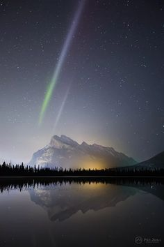 "Astrophotographer Paul Zizka shared this photo of the aurora phenomenon ""Steve"" — then called a potential proton arc — with Space.com in October 2015. He took the photo in Banff National Park in the Canadian Rockies on May 10, 2015."