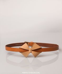 Leather crafting tutorial: DIY leather bow belt, inspired by the SEE BY CHLOÉ Bow Belt from their SS2012 collection (originally €150; €60 as on 6 Feb. 2014), https://www.perfectlybasics.nl/see-by-chloe-bow-belt-camel-0014010099632115.aspx. Tutorial on AubergineMoon.com, 25 Oct. 2012. #accessory #leatherbelt