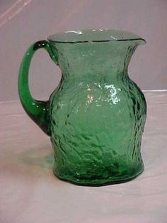 green glass pitcher. the ideal trio.