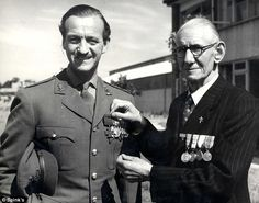 Kind: Corporal Arthur Cross lends his VC medal to actor David Niven who needed to use a real one in the film Carrington, VC , as stage tradition fo...