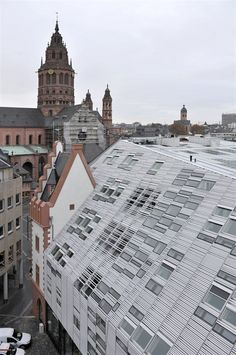 "Completed in 2008 in Mainz, Germany. Images by Moreno Maggi. The building complex is located in the middle of the city center of Mainz, Germany. Its existing ""historical"" facade shown to the Cathedral in. German Architecture, Amazing Architecture, Architecture Details, Interior Architecture, Installation Architecture, Museum Of Contemporary Art, Contemporary Architecture, Interior Exterior, Exterior Design"