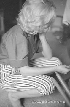 Marilyn in 'Schenck House' sitting at Joseph Schenck's house photographed by Milton H. Greene, 1953.