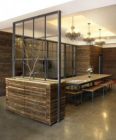 modern interior with wood and glass, dining room with table, chairs and chandelier