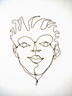 Wild Hair Boy's face--3-D steel wire sculpture