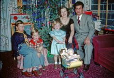 Christmas 1950s vintage photo...looks someone didn't receive his Red Ryder BB gun.