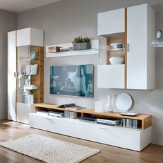 17 Neutral Living Room Cabinets Storage Ideas That You Will Love The challenging aspects of living room decor is choosing audio and media storage cabinets that mesh with the aesthetic of the room while keeping the contents organized. Room Design, Home Decor Bedroom, Living Room Cabinets, Living Room Wall Units, Tv Room Design, Bedroom Wall Units, Living Room Tv Unit Designs, Living Room Designs, Living Room Tv
