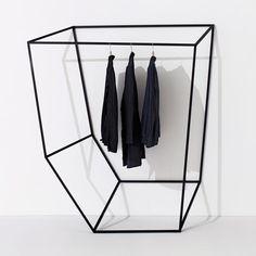 http://www.dezeen.com/2013/03/14/les-ailes-noires-clothes-rails-by-tongtong/ | Les Ailes Noires by +tongtong