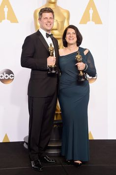Adam Stockhausen (L) and Anna Pinnock, winners of the Best Production Design Award for 'The Grand Budapest Hotel' pose in the press room during the 87th Annual Academy Awards at Loews Hollywood Hotel on February 22, 2015 in Hollywood, California.