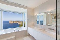 Bathtub with phenomenal sea views in new luxury villa in Cala Llamp - Puerto de Andratx in Mallorca - Sea view bathroom